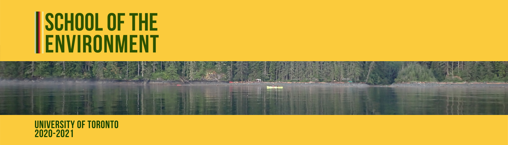 Kayak on a still lake with pine trees in the background.